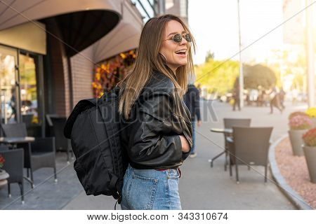 Young Adult Caucasian Woman Jeans Leather Jacket Backpack Street Modern Style Laughs Summer Vacation