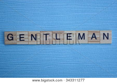 Gray Word Gentlemen From Small Wooden Letters On A Blue Table