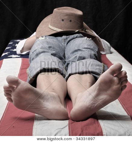 Deadly cowboy on a american flag. Economic crisis metaphor.