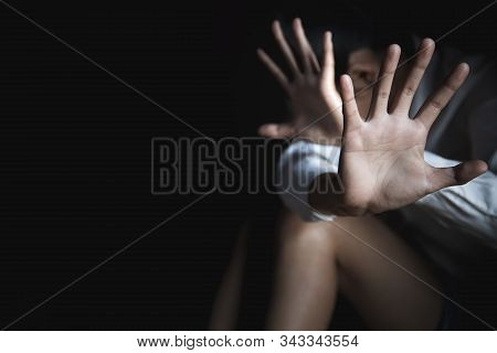 Scared Young Woman Sitting In The Corner Of Her Bedroom, Despair Rape Victim Waiting For Help,the Co