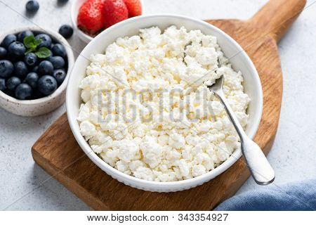 Curd Cheese, Cottage Cheese. Homemade White Cheese Crumbles In Bowl