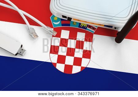 Croatia Flag Depicted On Table With Internet Rj45 Cable, Wireless Usb Wifi Adapter And Router. Inter