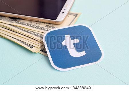 Tumblr Paper Logo Lies With Envelope Full Of Dollar Bills And Smartphone