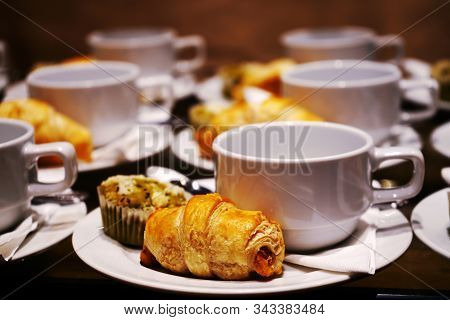 Bakery And Beverage On White Cup And Dish For Coffee Break Time At Party, Conference Or Seminar Busi
