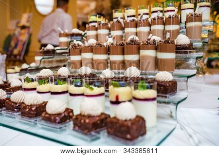 Catering. Off-site Food. Buffet Table With Various Sweet Chocolate Canapes, Sandwiches And Snacks Wi