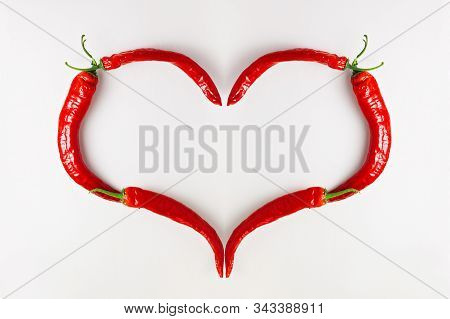 Red Chili Pepper Heart On White Wood Background. Love Hot Spicy Mexican Food, Valentine Day Concept.