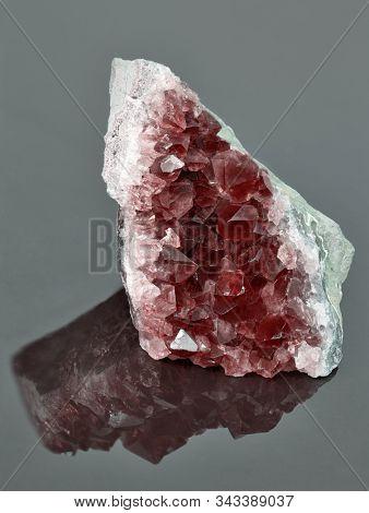 macro photo of red ruby druse on dark background