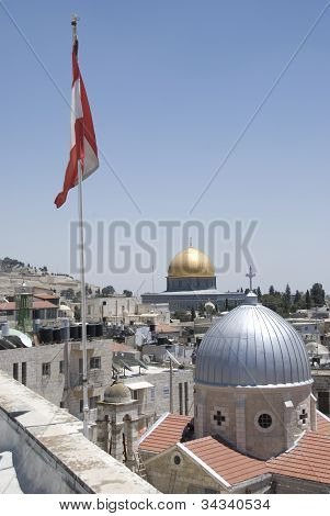 View to the Dome of the Rock in Jerusalem, Isreal, with the Austrian flag