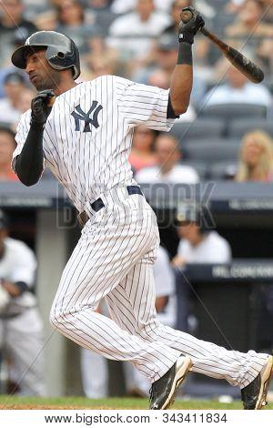 BRONX, NY - JUN 26: New York Yankees shortstop Eduardo Nunez (26) singles to left field against the Colorado Rockies on June 26, 2011 at Yankee Stadium.