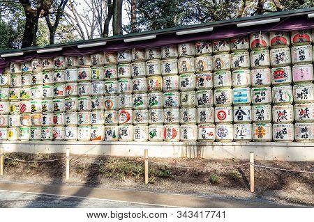 Traditional Sake Barrels Wrapped In Straw By Meiji Shrine