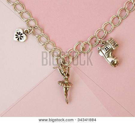 Charm Bracelet on Pink background