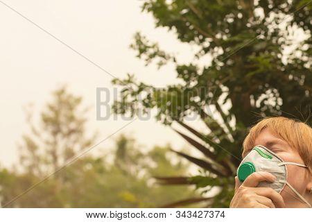 Australian Bushfire: Woman Wearing P2 N95 Protection Respiratory Mask To Reduce Amount Of Breathing