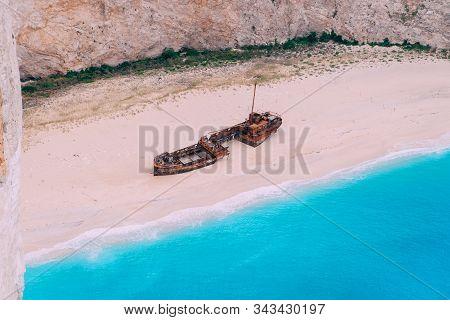 An Old Rusted Ship, Wrecked, Lies On The Seashore. Navagio Bay Shipwreck Beach Greece, Zakynthos