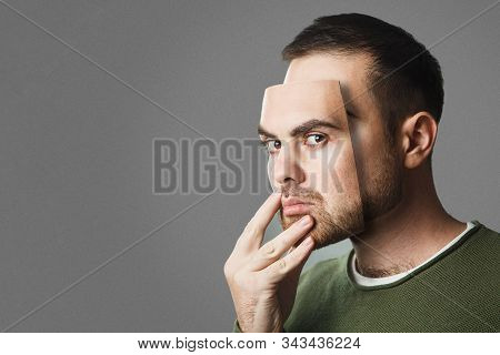 Be Yourself. Handsome Man Holds A Mask Of His Face