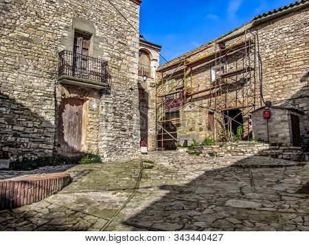 Spain, Montfalco Murallat - October 10, 2018: Scaffolding Near The Wall Of A Building In The Mediaev