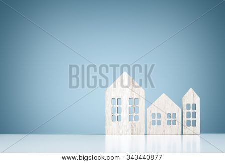 House real estate and construction background, wood model houses with blue copy space