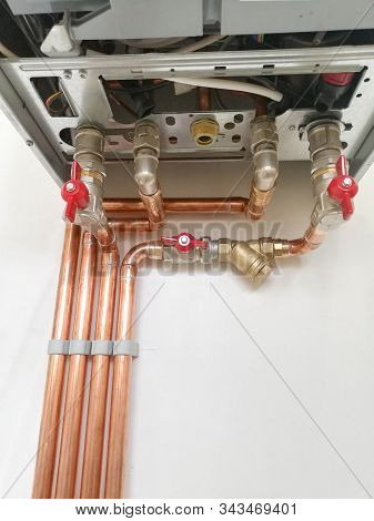 Copper Pipes Engineering In Boiler-room. Heating System With Copper Pipes