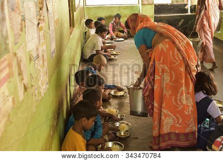 Jhargram, West Bengal, India - December 13, 2019: Mid Day Meal Program, An Indian Government Initiat