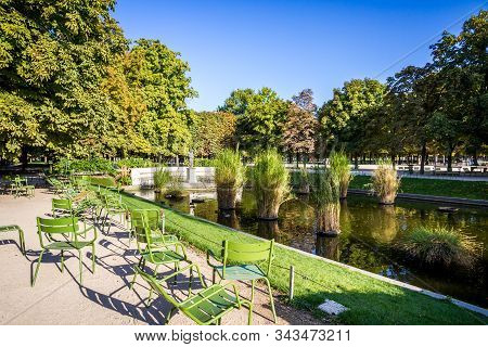 Aisles And Pond Of The Tuileries Garden In Summer Paris, France