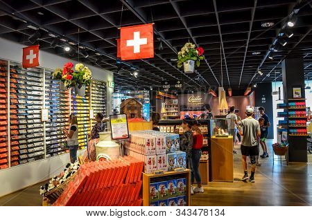 Broc, Switzerland - July 27, 2019: Visitors Of The Famous Cailler Chocolate Factory Buying Chocolate