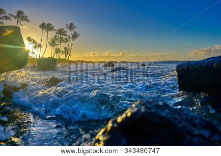 The Sunrise Over The Beach In Kauai, Hawaii