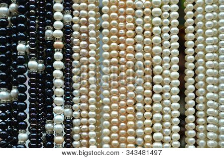Black And White Pearl Beads Background - Perl Necklaces Hanging At The Jewelry Shop - Horizontal Ima