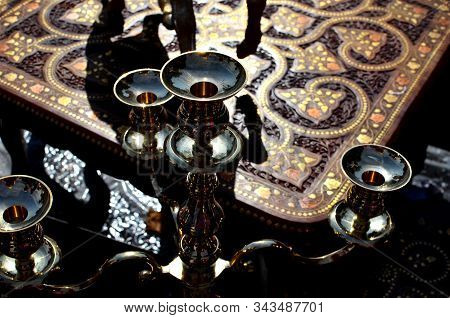 Mystic Oriental Background With Metallic Chandeliers And Wooden Carved Inlayed Table On The Indian M