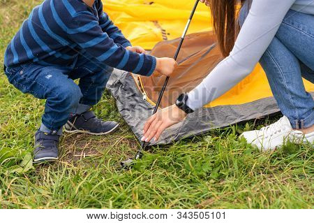 Happy Family With Little Son Set Up Camping Tent. Happy Childhood, Camping Trip With Parents. A Chil