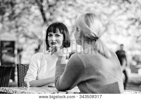Friendship Or Rivalry. Girls Friends Drink Coffee Talk. Conversation Of Two Women Cafe Terrace. Frie