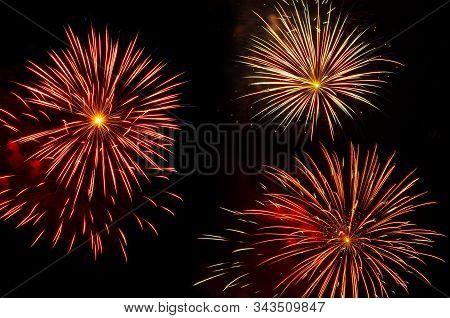 Colorful Bursts Of Vibrant Fireworks Trio Against Black Sky