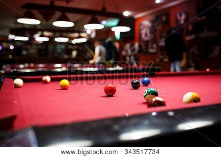 Boy Plays Billiard Or Pool In Club. Young Kid Learns To Play Snooker. Boy With Billiard Cue Strikes