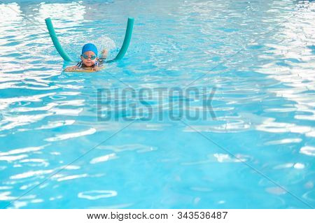 Cute Little Asian Toddler Boy Child Kicking Feet In Swimming Costume Wear Swimming Goggles Use Pool