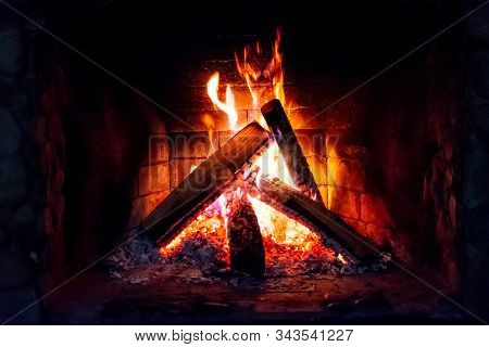 Flames In The Fireplace. Burning Wood. Brick Fireplace.