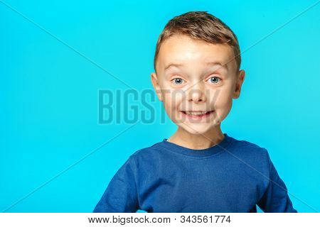 model child posing on turquoise background