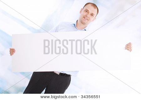 Full length of successful business man with a white banner