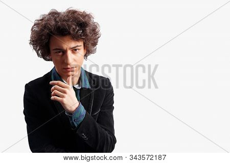 Indoor Shot Frustrated Male Frowns, Looks With Bewilderment, Reacts On Sudden Message, Isolated Over