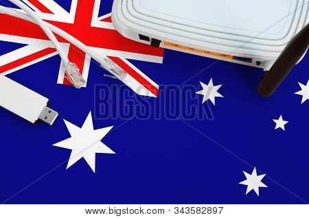 Australia Flag Depicted On Table With Internet Rj45 Cable, Wireless Usb Wifi Adapter And Router. Int