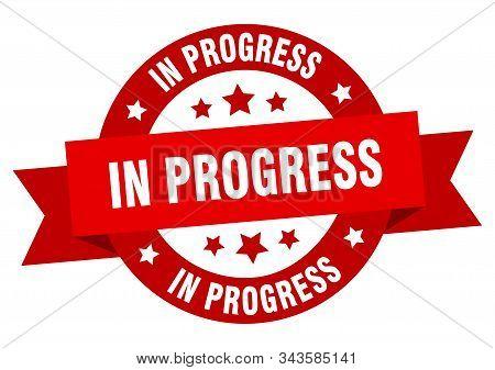 In Progress Ribbon. In Progress Round Red Sign. In Progress