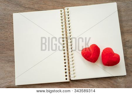 Couple Heart Shaped On Note Book Paper. Day 14 Meets Valentine Day. Red Heart Is The Promise Of Love