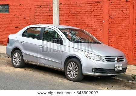 Oaxaca, Mexico - May 25, 2017: Grey Sedan Car Volkswagen Voyage In The City Street.