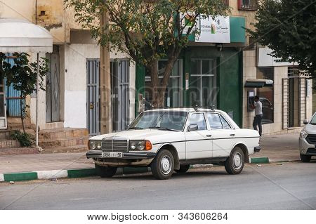 Khenifra Province, Morocco - September 27, 2019: White Motor Car Mercedes-benz E-class (w123) In The