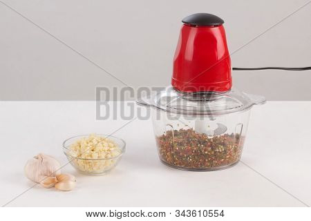 Food Processor With Chopped Chilli Inside Isolated On White Background