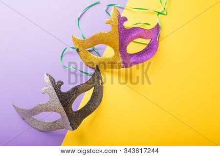 A Festive, Colorful Group Of Mardi Gras Or Carnivale Mask On A Purple Background. Venetian Masks.gol