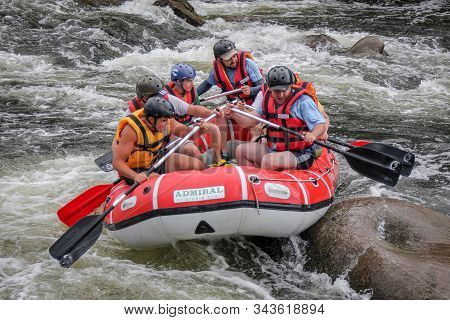 Maetaeng, Chiang Mai, Thailand, April​ 04,​ 2019: Young Person Rafting On The River, Extreme And Fun