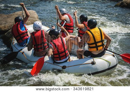 Rafting On The Bhote Koshi River In Nepal. Group Of Men And Women, Enjoy Water Rafting Activity At R