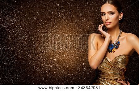 Fashion Model Beauty Portrait, Beautiful Elegant Woman In Luxury Gold Dress On Sparkling Background