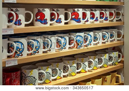 Minsk, Belarus - December 20, 2019: Ceramic Mugs On A Shelf In The Miniso Store With Images Of Marve
