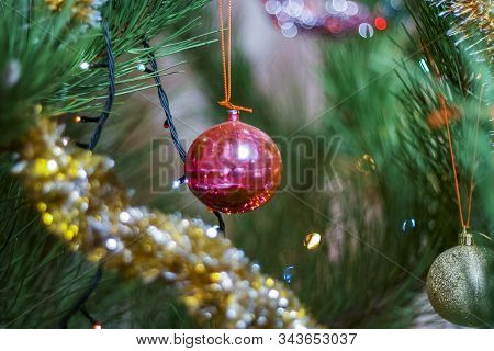 Glass Toy Hanging On A Christmas Tree