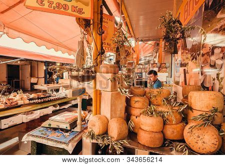 Palermo, Italy: Smoked Hard Cheese And Parmesan Wheels On The Stall Of Local Market Of Old City On 8
