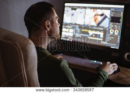 Video Montager Mounts Video At Desktop. Home Workstation